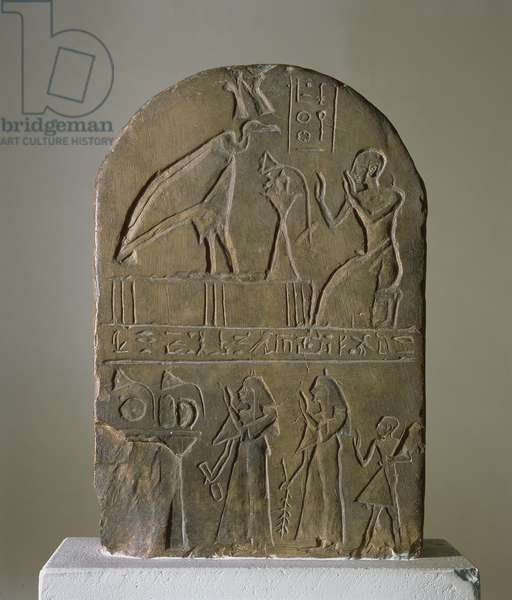 Stela of the vulture goddess Nekhbet of Nekheb (modern El-Kab) dedicated by a priest of the Temple of Horus Behdety who is shown in the top register, found at Edfu (limestone)