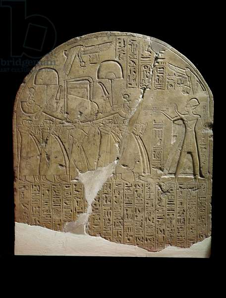 Stela dedicated to Isis by the overseer of works in the Temples of Ramesses II at Koptos, depicting the King offering incense to the sacred boat of Isis, carried by priests (limestone)