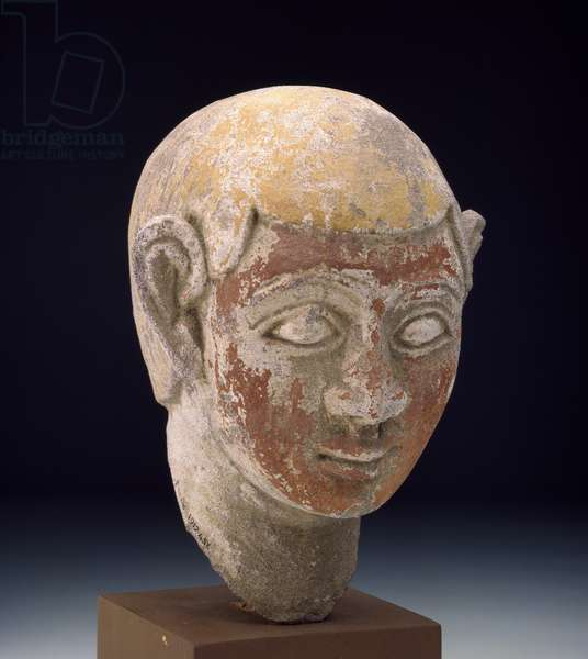 Painted sandstone head of a ba-statue, c.1-300 (carved grey standstone painted in red & yellow)