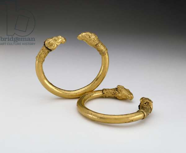 Pair of bracelets with rams' head terminals (bronze and gold)