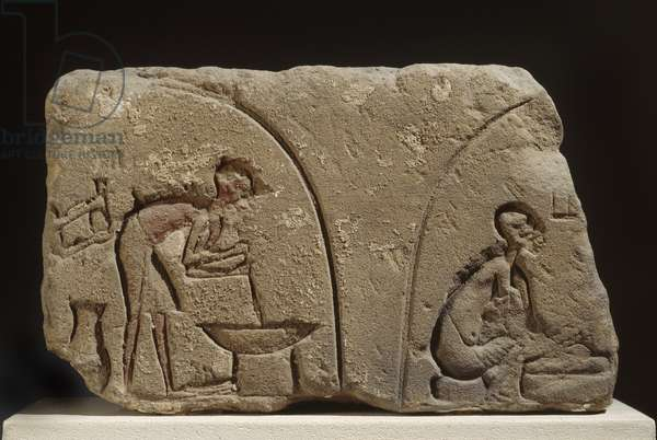 Sandstone relief of preparation of a meal (sandstone)