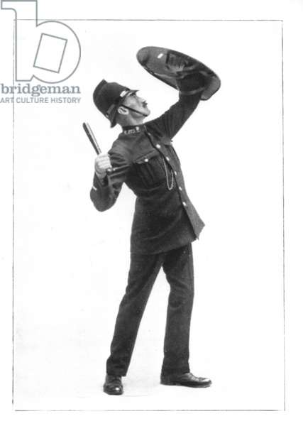 Pelted from the Roof - A policeman with a riot shield, 1912 (b/w photo)