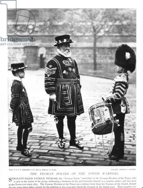 The Yeoman Porter of the Tower Wardens, Patrick Penrose, together with a small boy in the uniform of a Yeoman Warder and a drummer boy of the Grenadier Guards (b/w photo)