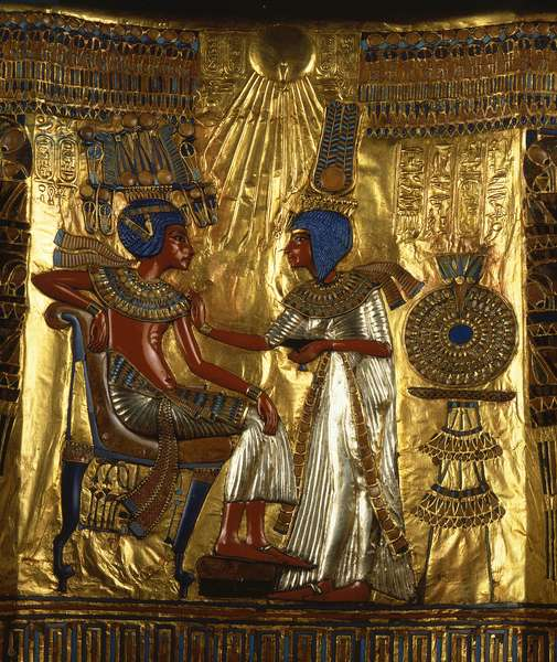 Egyptian antiquite: golden and painted wooden throne of Tutankhamun being part of the Pharaoh's Tresor (detail). Representation of Queen Ankhesenpaamon (Ankhesenpaamon, Ankhesenamon) who massages the shoulders of her brother and bridegroom Tutankhamon under the rays of the sun god Aton. Thebes. Around 1340 BC. From the tomb of All-Ankh-Amon (Tutankhamun or Tutankhamun), Valley of Kings, Deir el Bahari (Dayr al-Bahri). 18th dynasty. Dim. 104 cm Cairo. Egyptian Museum