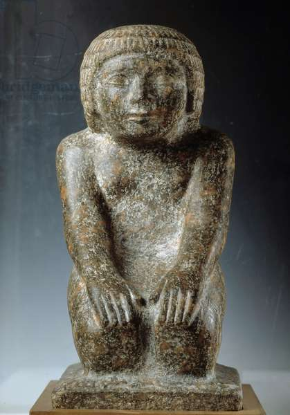 Granite statue of the priest Hetepdief, kneel in prayer position. 3rd dynasty, Old Empire. Cairo Museum of Egypt