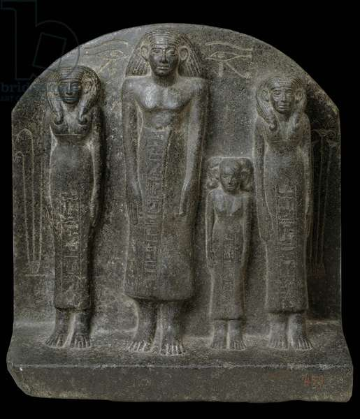 Egyptian antiquite: stele representing the notable Ukhhotep (Ukhotep or Ukh-hotep) surrounds his two wives and his daughter. Middle Empire. Museum of Egypt, Cairo