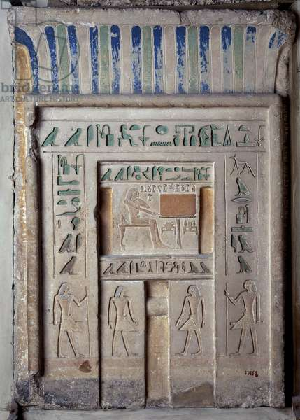 Antiquite Egyptian: false door (stele imitating the entrance of the pyramid) in painted limestone by Imem, senior official. He is represented there eating and drinking for eternity. From Sakkara (Saqqara). Museum of Egypt, Cairo.
