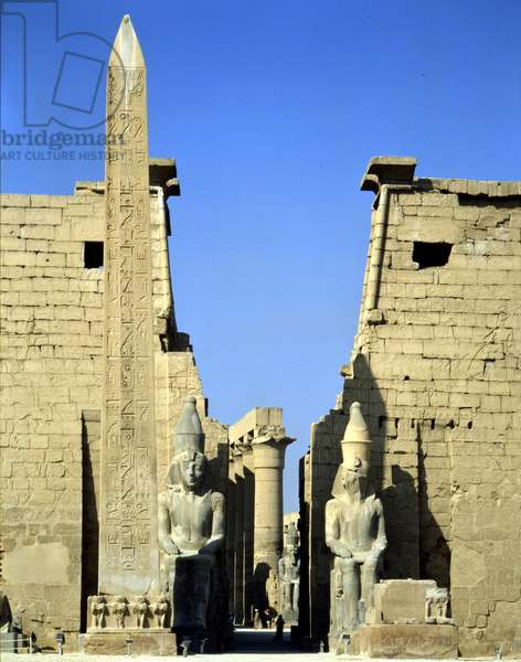 Temple First Pylon, detail with obelisk and colossal statues - Louksor or Luxor