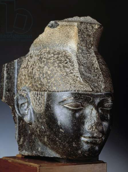 Egyptian antiquite: black granite head of Nubian king Taharka (or Taharqa). 25th dynasty, 3rd intermediate period. From Thebes. Museum of Egypt, Cairo