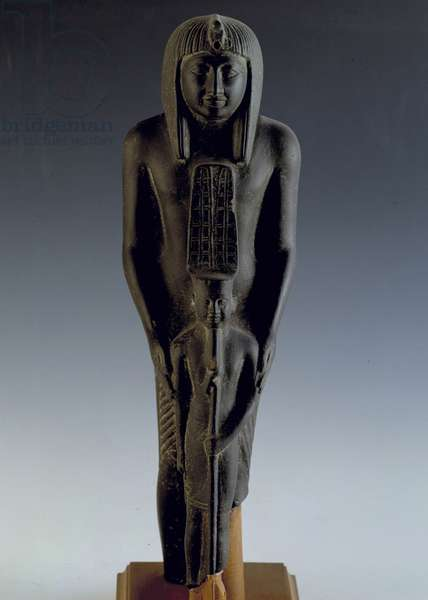 Egyptian antiquite: statue depicting the pharaoh Ramses VII (1135-1128 BC) with the deity Amon. 20th dynasty, New Empire. coming from Karnak. Museum of Egypt, Cairo