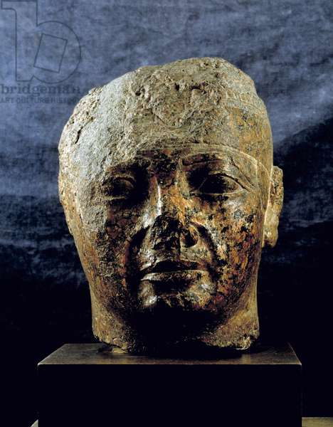 Egyptian antiquite: red granite head of Nubian king Taharka (or Taharqa). 25th dynasty, 3rd intermediate period. Museum of Egypt, Cairo