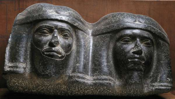 Egyptian antiquite: two granite head sculpted by African prisoners or slaves. Old Empire. From Tanis. Museum of Egypt, Cairo.
