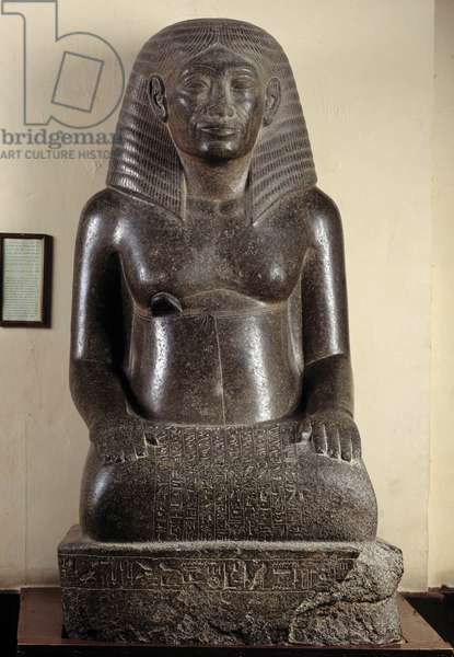 Egyptian antiquite: granite sitting statue depicting Amenhotep, scribe and royal architect, son of Hapou, as an old man. From the hiding place of Karnak. 18th dynasty, New Empire. Museum of Egypt, Cairo.