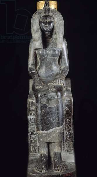 Egyptian antiquite: granite statue of Queen Isis, wife of Thutmosis II, 18th dynasty, new empire. From Karnak's hiding place. Museum of Egypt, Cairo.