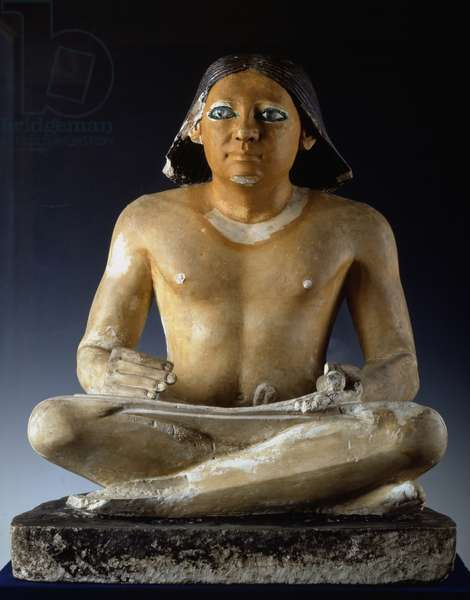Egyptian antiquite: detail of the limestone statue of a sitting scribe from the necropolis of Saqqara (Sakkara), 5th dynasty, ancient empire. Museum of Egypt, Cairo.