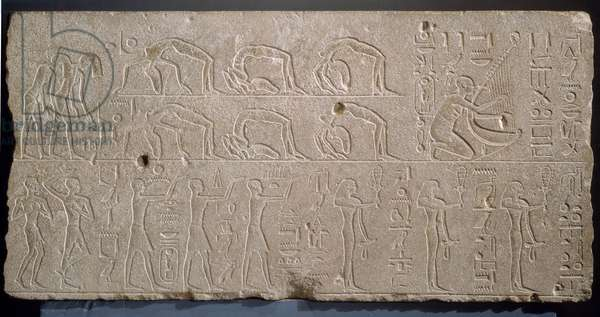 Antiquite Egyptian: relief in limestone depicting an entertainment scene with dancers and musicians. From Karnak. Museum of Egyptian Art Luxor (Luksor)