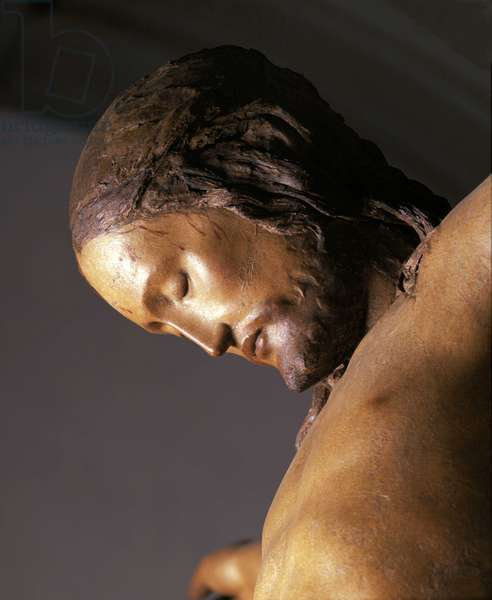 Crucifix: face of Christ. Renaissance sculpture by Michelangelo Buonarroti, known as Michelangelo Angelo (Michelangelo or Michelangelo, 1475-1564), 1492. Church of Santo Spirito, Florence.