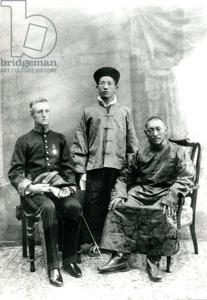 13th Dalai Lama (right) with Maharaja Kumar Sidkeong of Sikkim and Sir Charles Bell, studio portrait taken in Calcutta, 1910 (b/w photo)