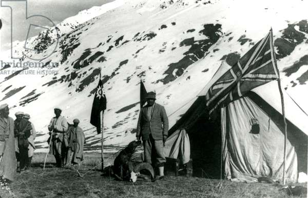 Tent in snowy mountain pass, Chinese & British flags fly, 1944 (b/w photo)