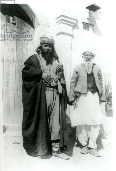 Two men in front of a doorway, c.1920-40 (b/w photo)