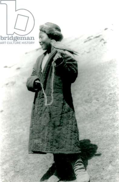 Boy holding a bird of prey, 1920s/1930s (b/w photo)