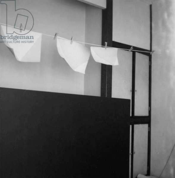 Hanging glazed papers in Anne Truitt's studio, c.1965 (b/w photo)