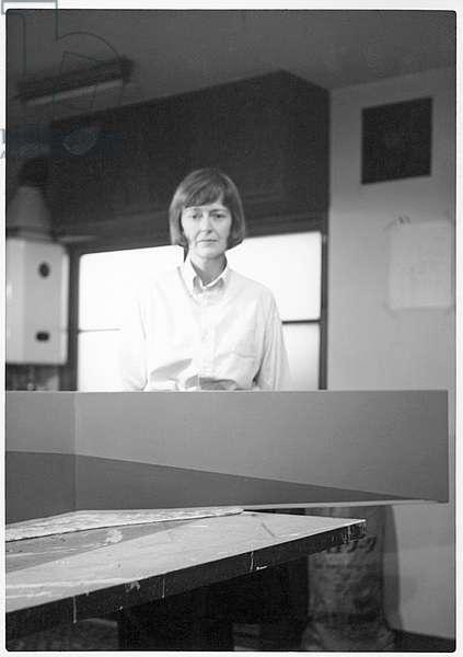 Anne Truitt in Otowa Studio, standing behind 'Sweet Wind' (b/w photo)