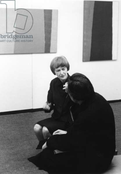 Anne Truitt at Minami Gallery with unidentified man, 1967 (b/w photo)