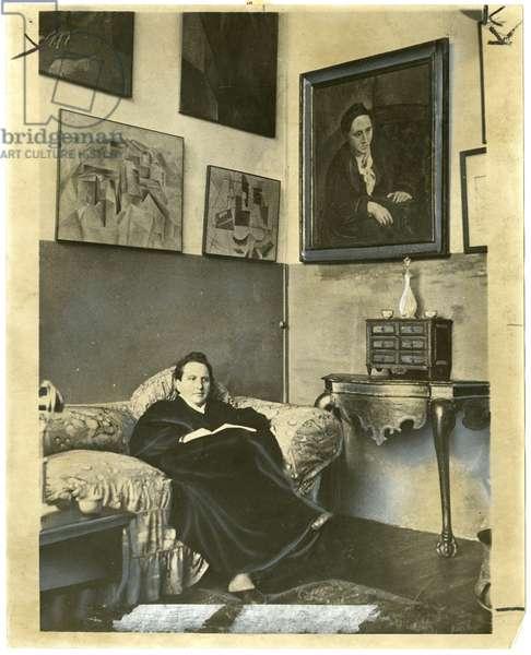 Gertrude Stein sitting on a sofa in her Paris Studio, 1930 (gelatin silver print)