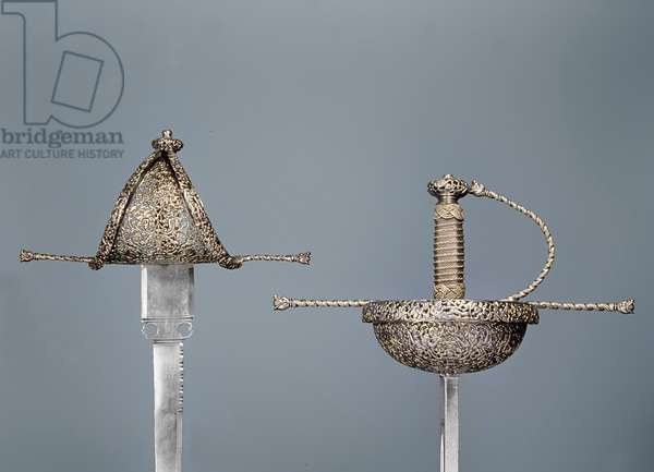 Swords: cup-hilted rapier of chiselled steel; left-handed dagger signed `Antonio Cilenta de Neapoli fecit', both 17th century