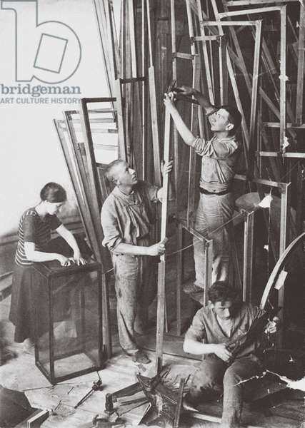 Tatlin while building the Monument to the Third International, 1919 (b/w photo)