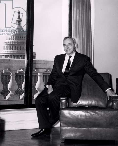 Saul Bellow (b.1915) seated in the Library of Congress Poetry Office (b/w photo)