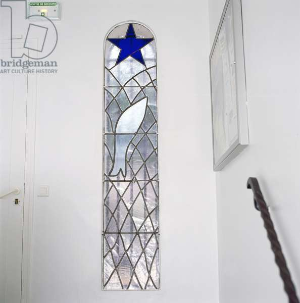 Stained glass window depicting a fish caught in a net beneath the Star of Salvation, from the stairs leading to the Chapel of the Rosary, 1948-51 (stained glass)