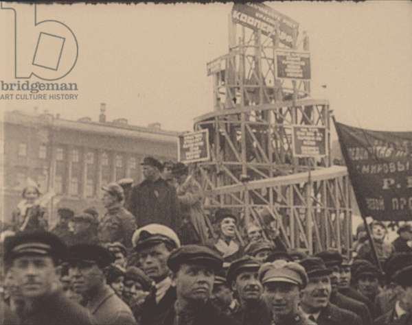 Parade with a model of Vladimir Tatlin's Monument to the Third International (1919-1920) in the streets on the May Day celebration in 1925 (b/w photo)