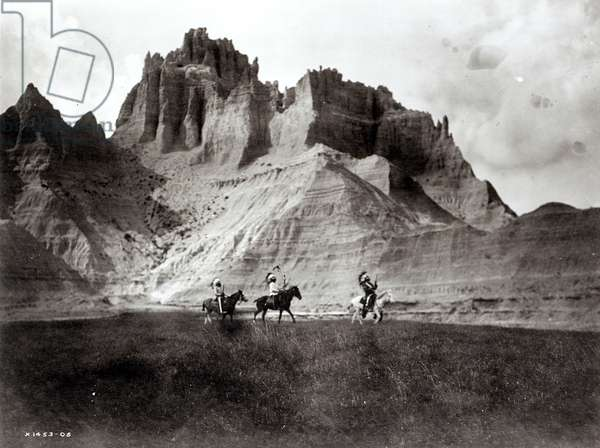 Entering the bad lands, three Sioux Indians on horseback, c.1905 (b/w photo)