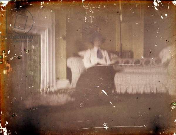 Woman sitting on a Sofa, c. 1910 (autochrome)