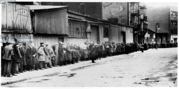 Breadline at McCauley Water Street Mission under Brooklyn Bridge, New York, c.1930-34 (b/w photo)