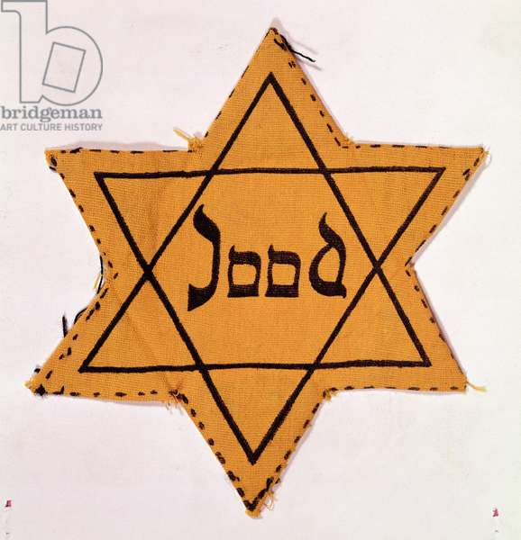 """Star of David cloth patch, printed """"Jood"""", as compulsorarily worn by Jews in Nazi Europe"""