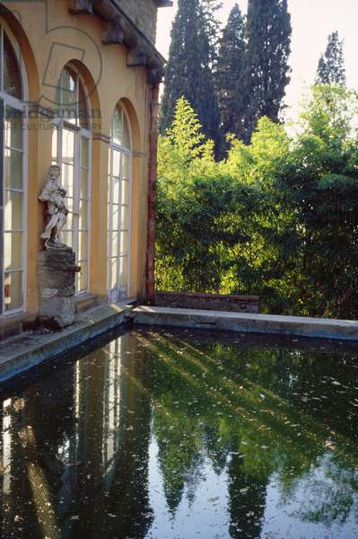 View of a pool outside the full length windows of the large salon at the rear of the Villa Il Riposo Dei Vescovi (photo)