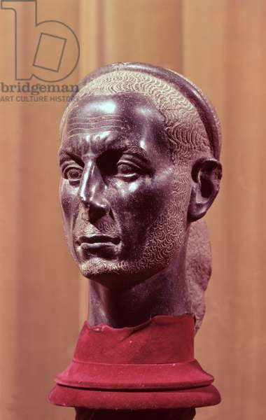Head of a statue of a bearded priest with a starred diadem, thought to be a portrait bust of Julius Caesar (c.100-44 BC), Egyptian, from the Nile Delta (diorite)