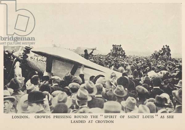 Crowds pressing round the Spirit of St Louis as she landed at Croydon