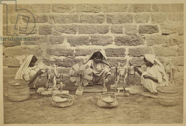 Female prisoners winding cotton on spinning wheels in Karachi Prison. Photographer: Michie and Company c.  1873173 mm x 260 mm Archaeological Survey of India Collections: India Office Series (Volume 52).