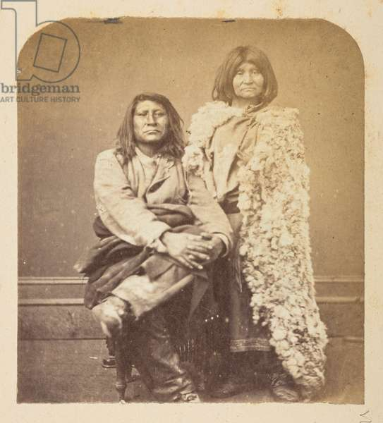 Full-length studio portrait of two American Indians, from the Lucas Collection: Photographic record of the world tour of Charles James and Morton P. Lucas, 1877-79 (b/w photo)