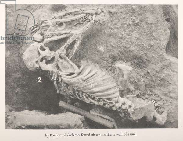 Portion of skeleton found above southern wall of same, from 'Mohenjo-Daro and the Indus Civilization' (b/w photo)