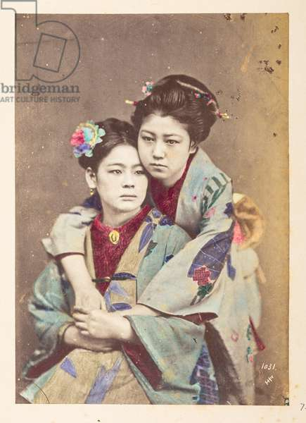Japanese women in traditional dress, Three-quarter length portrait of two young woman, one seated, the other leaning over her shoulder with her arms around her,  Photographer: UnknownLucas Collection: Photographic record of the world tour of Charles James and Morton P,  Lucas, 1877-79, Dimensions: 145 mm x 103 mm
