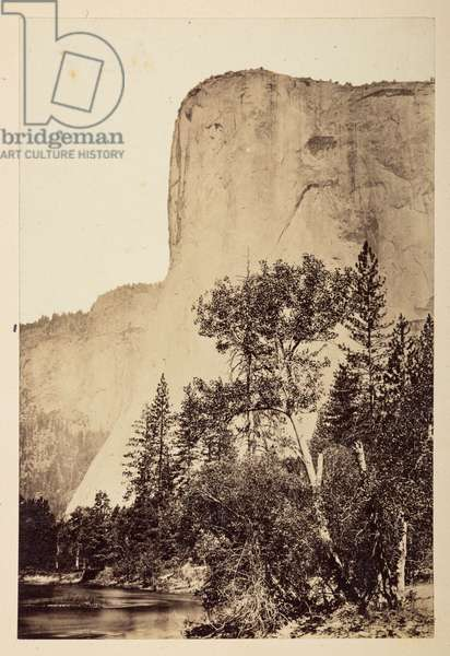 View towards the sheer face of El Capitan, with a river in the foreground, Yosemite Valley, 1865-70 (b/w photo)