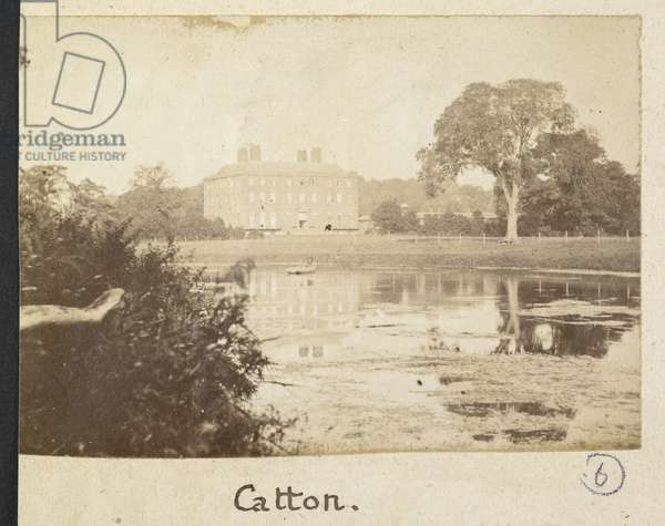 Catton. View of a house and a lake.