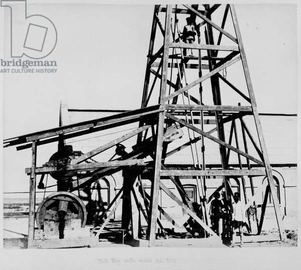 Well rig with man on top [Gulistan]. Construction of the Chaman Extension Railway (NWFP).