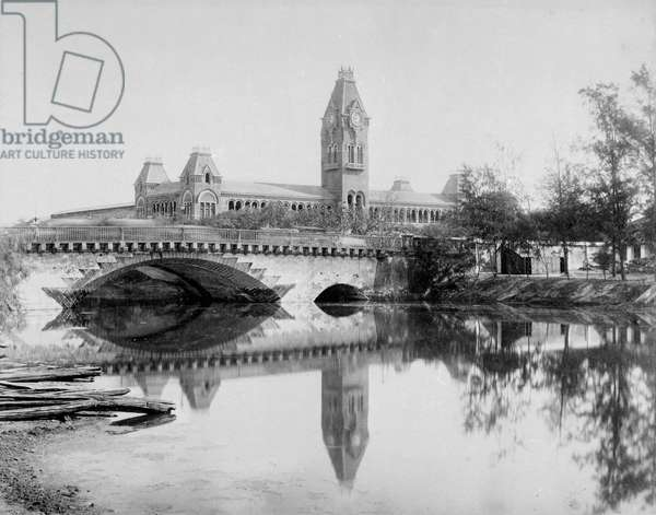 Central Railway Station [Madras]. View looking towards the station, with the stone bridge over the Cochrane Canal in the foreground. Photograph unsigned, but probably by Nicholas & Co.