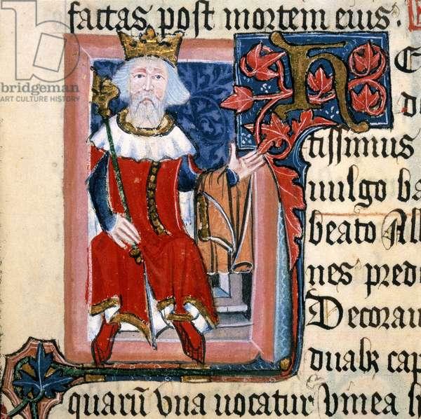 "Portrait d'Henri III (1207-1272), bienfaiteur royal de l'abbaye de Saint Albans, tenant un vetement. Lettre """"H"""" enluminee avec du lierre rouge. In """"la Chronique de St Albans"""" par Thomas Walsingham, 1380. British Library. Henry III, (1350-1400?). Page of illustrated Latin text showing King Henry III holding out his arm on which he carries a garment. Illuminated letter H with red ivy. From the Chronicle of St Albans by Thomas Walsingham. ©The British Library Board/Leemage"